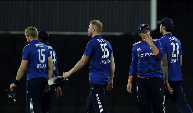 England players leave the field after losing the 3rd One Day International cricket match against South Africa at the Centurion Park stadium in Pretoria, South Africa, Tuesday, Feb. 9, 2016. South Afri