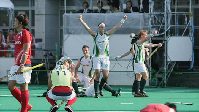 Japanese field hockey players (front) deject after their losing match against South Africa at the last world qualifying tournament in Kakamigahara, Gifu prefecture on May 6, 2012. South Africa won the last ticket to the London Olympics men's hockey when they defeated Japan 2-1 in the final qualifying tournament.    JAPAN OUT      AFP PHOTO / JIJI PRESSJIJI PRESS/AFP/GettyImages