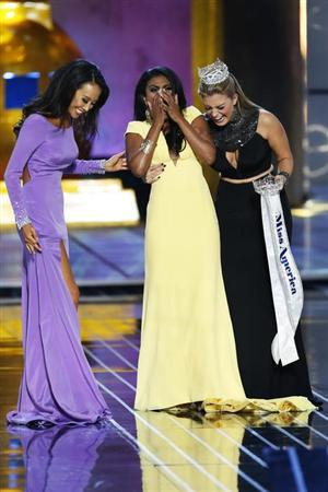 Miss America contestant, Miss New York Nina Davuluri (C) reacts with runner-up Miss California Crystal Lee (L) and 2013 Miss America Mallory Hagan after being chosen winner of the 2014 Miss America Pa