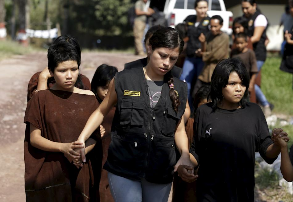 Peruvian anti-terrorist forces escort a group of people rescued from Shining Path rebels at Mazamari military base in the Amazon province of Satipo