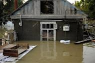 A flooded house stands in the southern Russian town of Krymsk. First funerals were held in the town of Krymsk, the worst hit area in southern Krasnodar region, as emergency workers pulled more bodies from the debris and survivors insisted they had not received any flood warning