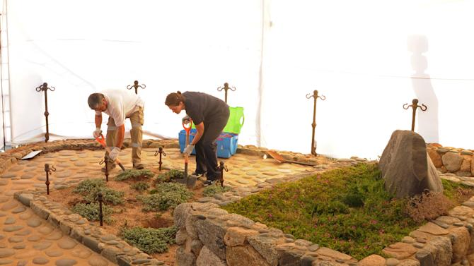 In this photo released by Chile's Judiciary, forensic specialists dig at the grave of Nobel laureate Pablo Neruda as they prepare for the exhumation of the remains in Isla Negra, Chile, Sunday April 7, 2013. The body of  Neruda will be exhumed in an effort to clear up four decades of suspicion about how the poet died in the days after Chile's military coup.(AP Photo / Judiciary of Chile)
