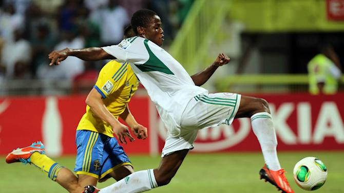 Chidera Ezeh of Nigeria tries to win the ball against Sweden during a semifinal soccer match of the World Cup U-17 at Rashid stadium in Dubai, United Arab Emirates, Tuesday, Nov. 5, 2013. (AP Photo)