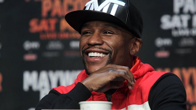 WBC/WBA welterweight champion Floyd Mayweather Jr. listens during a news conference