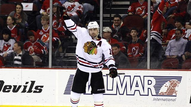Ice Hockey - Sharp fires Blackhawks to victory over Devils