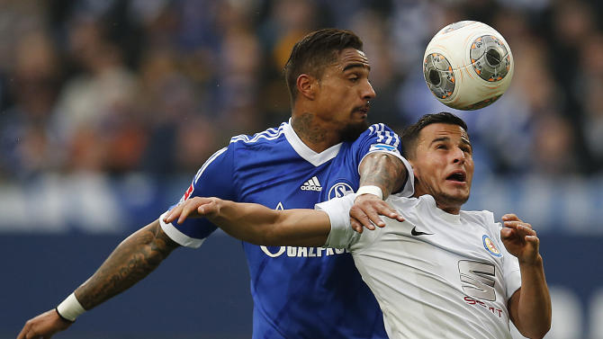 Schalke's Kevin-Prince Boateng of Ghana, left, and Braunschweig's Omar Elabdellaoui of Norway challenge for the ball during the German first division Bundesliga soccer match between Schalke 04 and Eintracht Braunschweig in Gelsenkirchen , Germany, Saturday, March 22, 2014