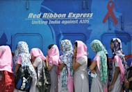 Indian nursing trainee students wait to board the Red Ribbon Express train during an HIV/AIDS awareness campaign at a railway station in Secunderabad, in June. A cure for AIDS remains a distant prospect but a host of drug treatments and other advances have fueled fresh hope that new human immunodeficiency virus infections may some day be halted for good