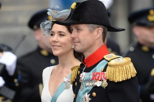 Denmark's Crown Prince Frederik (R) and his wife Crown Princess Mary arrive to attend on April 30, 2013 a reception held by King Willem-Alexander of the Netherlands at the Royal Palace in Amsterdam fo