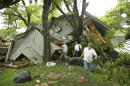 Jeremy Steele, left, Ric Jaime, center, and Keith McNabb salvage belongings at their friend Mike Cook's house near Wimberley, Texas, Sunday, May 24, 2015. About 350 homes in the town of Wimberley were washed away by flash floods along the Blanco River, which rose 26 feet in just one hour and left piles of wreckage 20 feet high, Texas authorities said. (Jay Janner/Austin American-Statesman via AP) AUSTIN CHRONICLE OUT, COMMUNITY IMPACT OUT, INTERNET AND TV MUST CREDIT PHOTOGRAPHER AND STATESMAN.COM, MAGS OUT