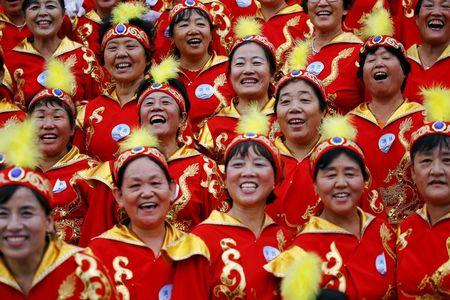 Women who participated in a program at the Bird's Nest Olympic stadium celebrate after Beijing was chosen to host the 2022 Winter Olympics in Beijing