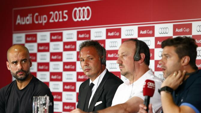 Coaches Guardiola of Bayern Munich, Mihajlovic of AC Milan, Benitez of Real Madrid and Pochettino of Tottenham Hotspur attend a news conference on the eve of their pre-season Audi Cup tournament, in Munich