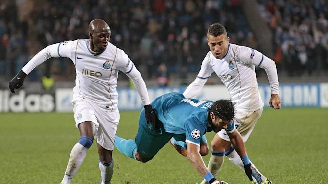 Zenit's Hulk, centre, is sent flying by a tackle during the Champions League group G soccer match between Zenit and Porto at Petrovsky stadium in St.Petersburg, Russia, on Wednesday, Nov. 6, 2013