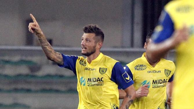 Chievo forward Cyril Thereau of France, celebrates after scoring during a Serie A soccer match against Juventus at Bentegodi stadium in Verona, Italy, Wednesday, Sept. 25, 2013