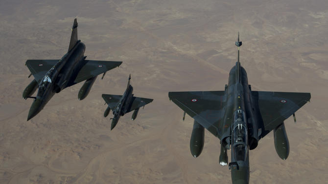 This picture released by the French Army Communications Audiovisual office (ECPAD) shows French Mirage 2000 D aircraft flying to N'Djamena overnight January 11 to 12, after taking off from the French military base of Nancy. The battle to retake Mali's north from the al-Qaida-linked groups controlling it began in earnest Saturday, after hundreds of French forces deployed to the country and began aerial bombardments to drive back the Islamic extremists from a town seized earlier this week. (AP Photo/ R.Nicolas-Nelson, Ecpad)