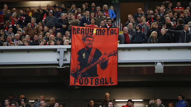 Liverpool fans hold up a banner of manager Juergen Klopp before the match