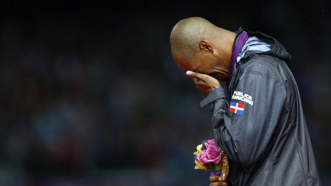 Felix Sanchez of the Dominican Republic cries after receiving his gold medal during the men's 400m hurdles victory ceremony at the London 2012 Olympic Games