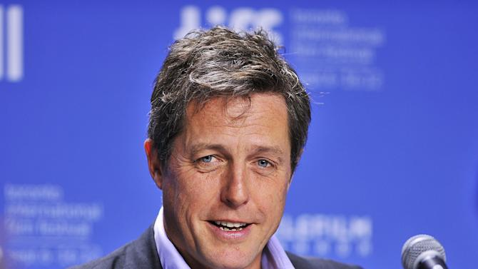 """FILE - In this Sept. 9, 2012 file photo, actor Hugh Grant speaks during the news conference for the film """"Cloud Atlas"""" during the 2012 Toronto International Film Festival in Toronto. Hugh Grant was among 17 hacking victims who settled Friday Feb. 8, 2013 with News Corp. subsidiary News Group Newspapers over its campaign of illegal espionage, which set off a massive scandal when it was revealed in July 2011. (AP Photo/The Canadian Press, Aaron Vincent Elkaim, File)"""