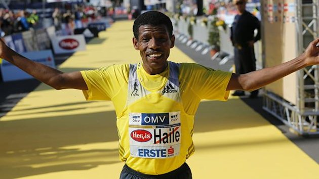Ethiopian Haile Gebrselassie celebrates after winning the half marathon race during the Vienna City Marathon in Vienna April 14, 2013. REUTERS