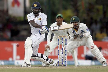 Sri Lanka's Mathews hits a four next to Pakistan's wicketkeeper Ahmed and Khan during the final day of their second test cricket match in Colombo