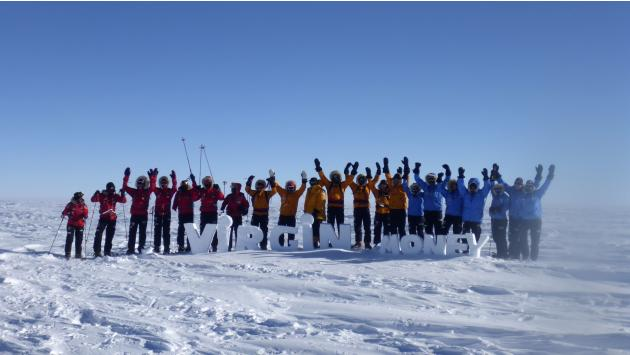 Teams pose for a picture on the first day of the Virgin Money South Pole Allied Challenge 2013 expedition in Antarctica