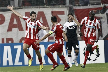 Olympiakos Piraeus' Manolas celebrates with team-mate Maniatis after scoring against Benfica during their Champions League soccer match in Piraeus near Athens
