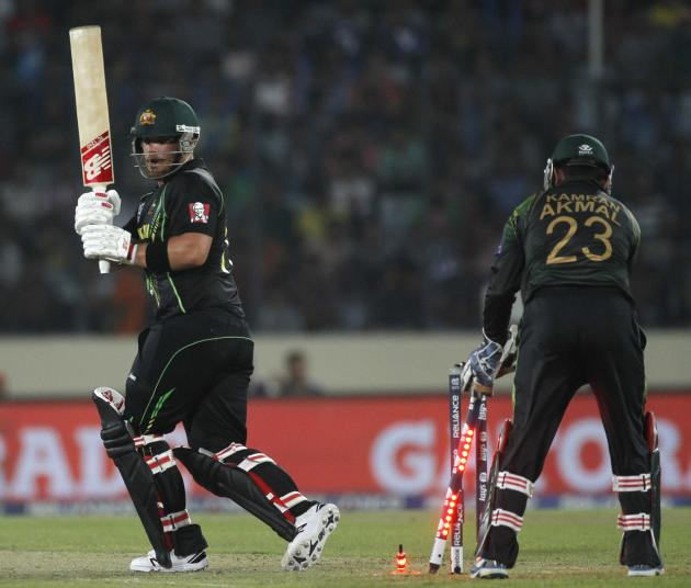 Australia's Aaron Finch is bowled out against Pakistan as wicketkeeper Kamran Akmal watches during their ICC Twenty20 World Cup match at the Sher-E-Bangla National Cricket Stadium in Dhaka