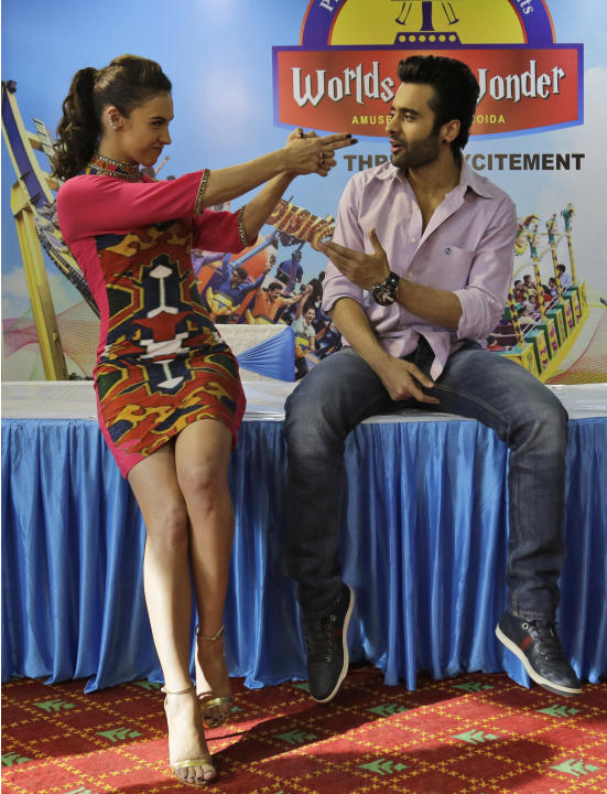 """Bollywood actors Lauren Gottlieb, left, and Jackky Bhagnani attend a promotional event for their upcoming movie """"Welcome to Karachi"""" in New Delhi, India, Friday, May 22, 2015. The film is sc"""