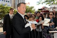 """Actor Tom Hanks signs autographs at the """"Cloud Atlas"""" premiere during the 2012 Toronto International Film Festival on September 8, 2012"""