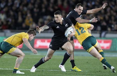 Sonny Bill Williams of New Zealand's All Blacks looks to fend off Michael Hooper of Australia's Wallabies' in their Bledisloe Cup rugby union test match in Auckland