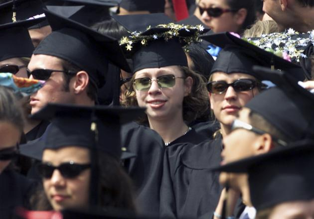 File photo of Chelsea Clinton standing with fellow members of the 2001 Stanford University graduating class