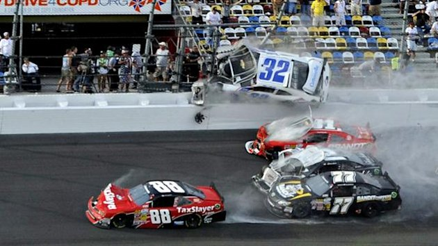 NASCAR driver Kyle Larson (32) and his Chevrolet end up in the fence during the final lap crash during the NASCAR Nationwide Series DRIVE4COPD 300 race at the Daytona International Speedway in Daytona Beach, Florida (Reuters)