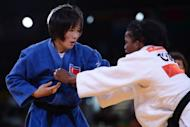 """North Korea's An Kum-Ae during her women's -52kg judo final against Cuba's Yanet Bermoy Acosta at the London Olympics on July 29. """"She owes her success to the great leaders, the benevolent social system and the (ruling) Workers' Party of Korea,"""" An's father An Jong-Ryon was quoted as saying"""