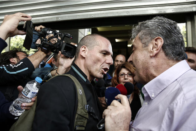Greece's Finance Minister Yanis Varoufakis talks with a unionist during a protest by tax office employees outside the Finance ministry in Athens, Greece, Thursday, April 30, 2015. Varoufakis has i