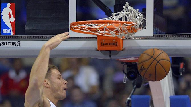 Los Angeles Clippers forward Blake Griffin dunks during the first half of an NBA basketball game against the Utah Jazz, Saturday, Dec. 28, 2013, in Los Angeles