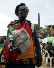 A Zimbabwean mourner wears a shirt bearing a portrait of Robert Mugabe during a ceremony at the National Heroes Acre, in Harare, on January 21, 2013