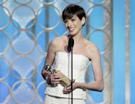 "This image released by NBC shows Anne Hathaway with her award for best supporting actress in a motion picture for her role in ""Les Miserables"" during the 70th Annual Golden Globe Awards at the Beverly Hilton Hotel on Jan. 13, 2013, in Beverly Hills, Calif. (AP Photo/NBC, Paul Drinkwater)"