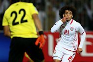 Emirati footballer Omar Abdul Rahman celebrates after scoring a goal against Iraq in the final match of the 21st Gulf Cup in Manama, on January 18, 2013. United Arab Emirates defeated Iraq 2-1 in extra-time to claim the 21st Gulf Cup in a thrilling final