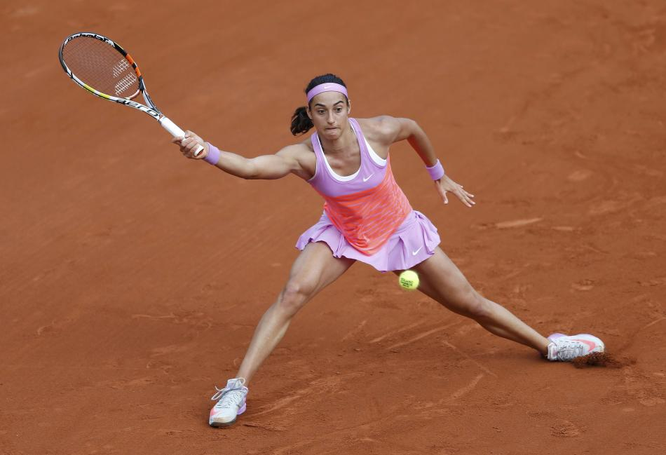 Caroline Garcia of France plays a shot to Donna Vekic of Croatia during the women's singles match at the French Open tennis tournament at the Roland Garros stadium in Paris