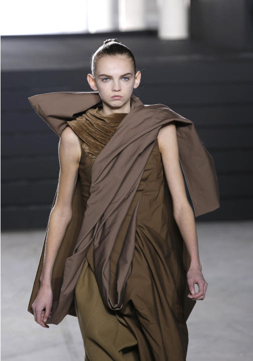 A model wears a creation for American designer Rick Owens' fall-winter 2015-2016 ready to wear fashion collection, presented at Paris fashion week, Paris, France, Thursday, March 5, 2015. (AP Phot