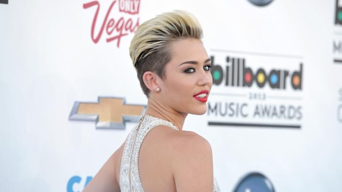 Miley Cyrus arrives at the Billboard Music Awards at the MGM Grand Garden Arena on Sunday, May 19, 2013 in Las Vegas. (Photo by John Shearer/Invision/AP)