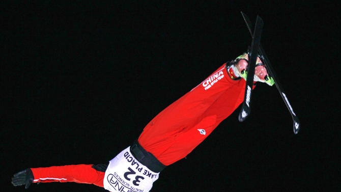 China's Liu Zhongqing competes in the men's aerials World Cup freestyle skiing event in Lake Placid, N.Y., on Friday, Jan. 20, 2012. Zhongging finished second in the event. (AP Photo/Mike Groll)