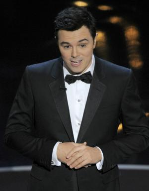 Host Seth MacFarlane speaks onstage during the Oscars at the Dolby Theatre on Sunday Feb. 24, 2013, in Los Angeles.  (Photo by Chris Pizzello/Invision/AP)