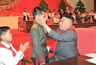 Picture released by North Korea's official Korean Central News Agency (KCNA) shows North Korean leader Kim Jong-Un (R) attending the 7th Congress of the Korean Children's Union (KCU) in Pyongyang, June 6, 2013. North and South Korea on Saturday agreed to hold working-level talks on Sunday in the border truce village of Panmunjom, following months of soaring tension