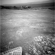 The smaller Odyssey crater, perched on the rim of the giant crater, Endeavour, was one of the sites examined by Opportunity.