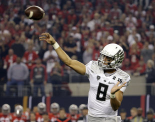 Oregon's Marcus Mariota throws during the first half of the NCAA college football playoff championship game against Ohio State Monday, Jan. 12, 2015, in Arlington, Texas. (AP Photo/David J. Phillip)