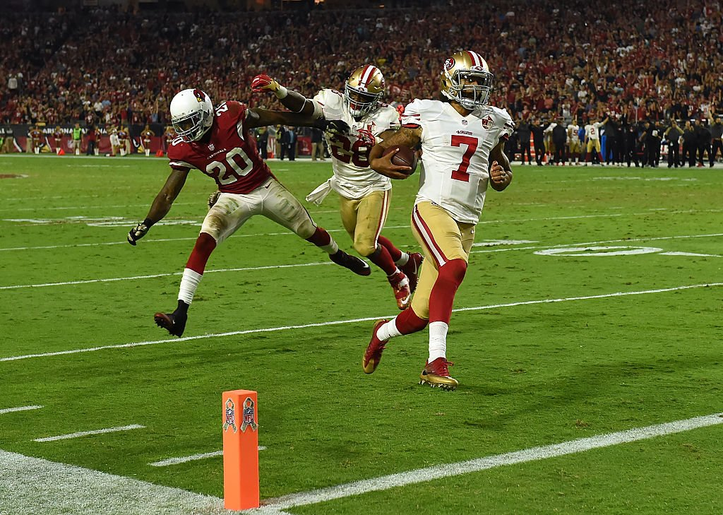 Colin Kaepernick makes a house call against the Cardinals. (Photo by Norm Hall/Getty Images)