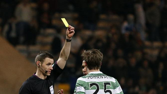 Celtic's Stefan Johansen is booked following his goal celebration against Partick Thistle during their Scottish Premier League soccer match at Firhill Stadium in Glasgow