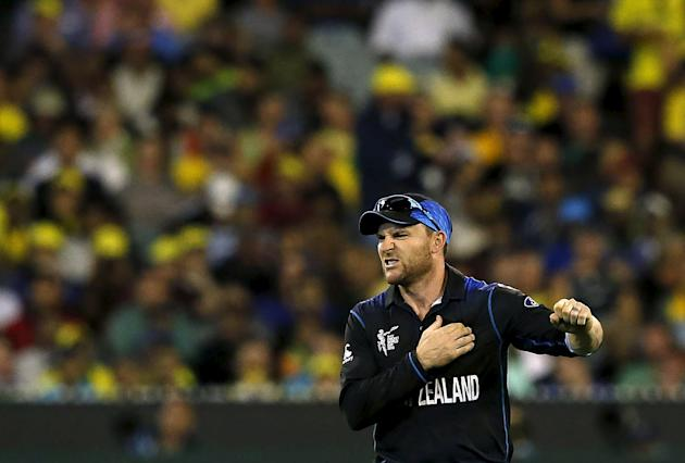 New Zealand's captain Brendon McCullum reacts after he fell when fielding a ball hit by Australia's captain Michael Clarke during their Cricket World Cup final match at the MCG