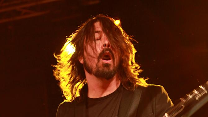 IMAGE DISTRIBUTED FOR PARK CITY LIVE - Dave Grohl, of the Foo Fighters performs with the Sound City Players at Park City Live Day 2 on Friday, January 18, 2013, in Park City, Utah. (Photo by Barry Brecheisen/Invision for Park City Live/AP Images)