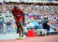 US' LaShawn Merritt applies ice on his leg after pulling up in the Olympic men's 400m heats. Merritt, the American sprinter who was favourite to retain his 400m title at the London Olympics, pulled up in his heat on Saturday and limped off the track